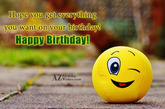 Birthday greeting with a winking emoticon on a toy ball… - AZBirthdayWishes.com