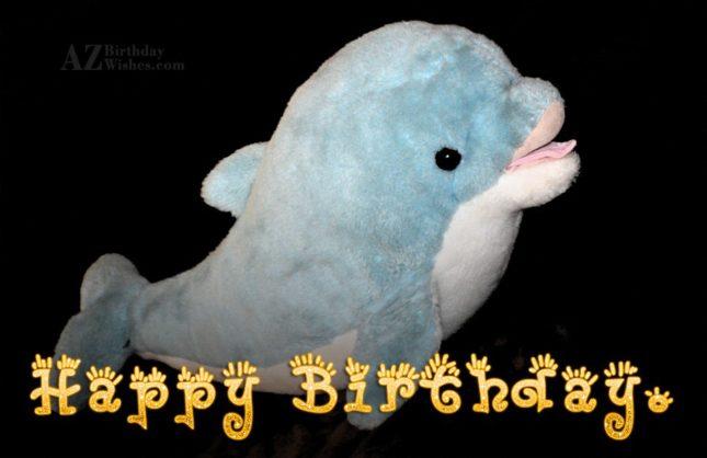 Happy birthday on a toy dolphin… - AZBirthdayWishes.com