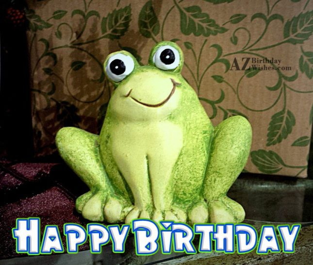 Happy birthday with frog statue in background - AZBirthdayWishes.com